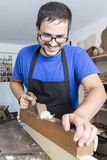 Luthier working in his workshop Royalty Free Stock Images