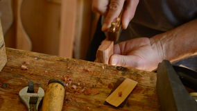 Luthier working with mini wood planer in guitar, close up stock video