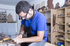 Luthier working the rosette Royalty Free Stock Images