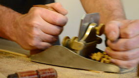 Luthier working with a wood planer Stock Photo