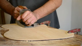 Luthier working with a wood planer stock video