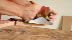 Luthier working with a wood planer in a mastil guitar Stock Image