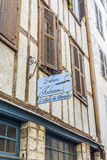 Luthiers signboard in a facade of typical building of Aquitaine. Stock Photos