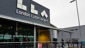 Luton Airport name sign seen at the front welcoming part of the airport. London, United Kingom - March 22, 2019: Luton Airport name sign seen at the front royalty free stock image