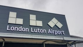 Luton Airport name sign seen at the front welcoming part of the airport. London, United Kingom - March 22, 2019: Luton Airport name sign seen at the front stock photos