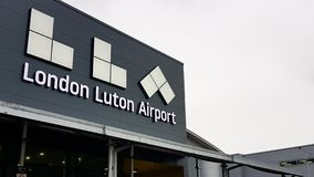 Luton Airport name sign seen at the front welcoming part of the airport. London, United Kingom - March 22, 2019: Luton Airport name sign seen at the front stock images