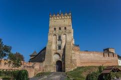 Lutsk castle with the Ukrainian flag on top. Castle in Lutsk with the Ukrainian flag on top Stock Photo