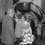 Bride hugging relatives Stock Photography