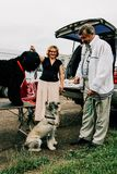 Man and woman with dogs. LUTSK, Volyn / UKRAINE - June 20 2009: Unknown man and woman with dogs at park in summer Stock Images