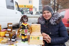 Woman sell honey Stock Images