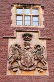 Coat of Arms at Dunster Castle. The Luttrell coat of arms is held above the castle entrance. The castle dates back to the 11th century and has been expanded stock photos