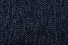Luva protetora de couro de KINDLE no protetor do ebook de KINDLE do couro do textureBlack na parte de trás da textura de pano Fotografia de Stock Royalty Free