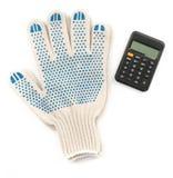 Luvas com calculadora Foto de Stock Royalty Free