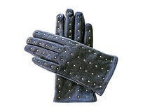 Luvas de couro pretas com os rebites do metal isolados no backgro branco Fotografia de Stock