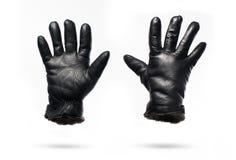 Luvas de couro pretas do inverno isoladas no fundo branco Fotos de Stock Royalty Free