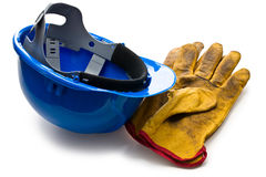 Luvas de trabalho azuis do capacete de segurança e do couro Imagens de Stock Royalty Free