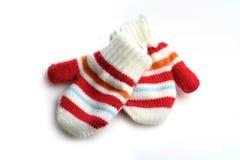 Luvas do bebê no fundo branco Fotografia de Stock