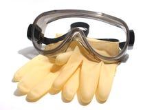 Luvas e óculos de proteção imagens de stock royalty free