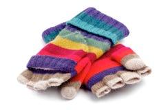 Luvas listradas do arco-íris com dedos Foto de Stock Royalty Free