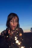 Lux del soplando de Chica Fotografía de archivo