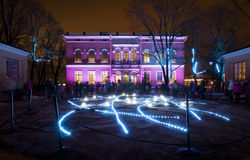 Lux Finland 2013. Unknown people looking at Lux Helsinki - family event - light installations in the courtyard of Hakasalmi Villa on January 5, 2013 in Helsinki Stock Photography
