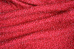 Lux Red Beaded Fabric. Detail of a densely beaded red fabric stock photo
