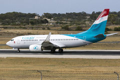 Luxair 737 backtracking runway 31. Royalty Free Stock Photography