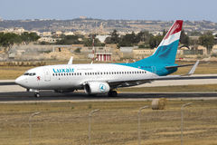 Luxair 737 backtracking runway 31. Royalty Free Stock Photo