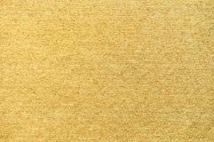 Luxe gouden oppervlakte van stoffenmateriaal Stock Afbeelding