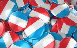 Luxembourg Badges Background - Pile of Luxembourgish Flag Button. S. 3D Rendering Stock Images