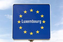 Luxembourg border sign. Blue Luxembourg border road sign stock photo