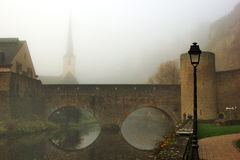 Luxembourg bridge over Alzette river in the fog Stock Photo