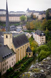 Luxembourg Church And River. A view over the lower city of Luxembourg from the ramparts of the fortress of the old city area. An old church by the Alzette river stock photography