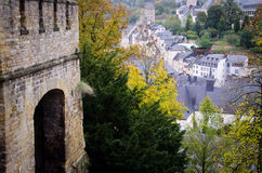 Luxembourg city and city wall. A view over the old quarter of Luxembourg, the lower town from the upper town and with a historic fortress wall on the side of the stock photos