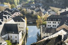 Luxembourg city details. Top view with bridge across Alzette river. In downtown Luxembourg and details of traditional vintage houses in dark November day Stock Image