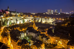 Luxembourg city. Historical old town center night scene (Grund) and Kirchberg office buildings in second plan Royalty Free Stock Images