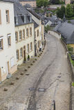 LUXEMBOURG CITY - LUXEMBOURG - JUNE 30, 2016: Narrow medieval st Stock Photos