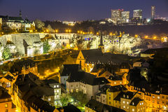 Luxembourg city old and new. Luxembourg city historical old town center night scene (Grund) and new part Kirchberg in second plan Royalty Free Stock Photo