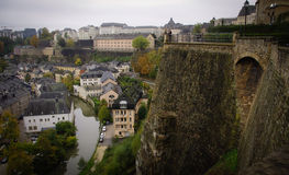 Luxembourg city and walls. A view over the Alzette/Uelzecht river from the ramparts of the fortress of the old city area of Luxembourg to the city below stock image