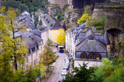 Luxembourg city and walls. A view over the old quarter of Luxembourg, the lower town from the upper town and with a historic fortress wall in the background royalty free stock photography