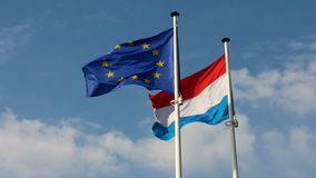 Luxembourg and European Union flags stock video