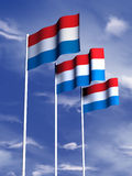 Luxembourg flag. The flag of Luxembourg flying in a soft breeze vector illustration