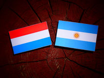 Luxembourg flag with Argentinian flag on a tree stump isolated Stock Photos