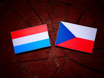 Luxembourg flag with Czech flag on a tree stump. Luxembourg flag with Czech flag on a tree stump Royalty Free Stock Photos
