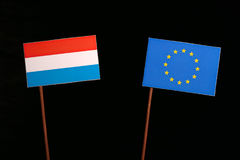 Luxembourg flag with European Union EU flag isolated on black. Background Royalty Free Stock Photography