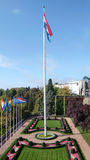 Luxembourg flag and garden. Elevated view of Luxembourg flag in landscaped garden, Luxembourg city Royalty Free Stock Images