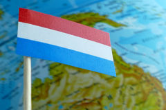 Luxembourg flag with a globe map as a background Royalty Free Stock Photography