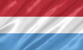 Luxembourg Flag. With waving on satin texture stock illustration