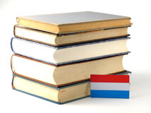 Luxembourg flag with pile of books  on white background. Luxembourg flag with pile of books  on white Royalty Free Stock Image