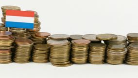 Luxembourg flag with stack of money coins. Luxembourg flag waving with stack of money coins stock footage